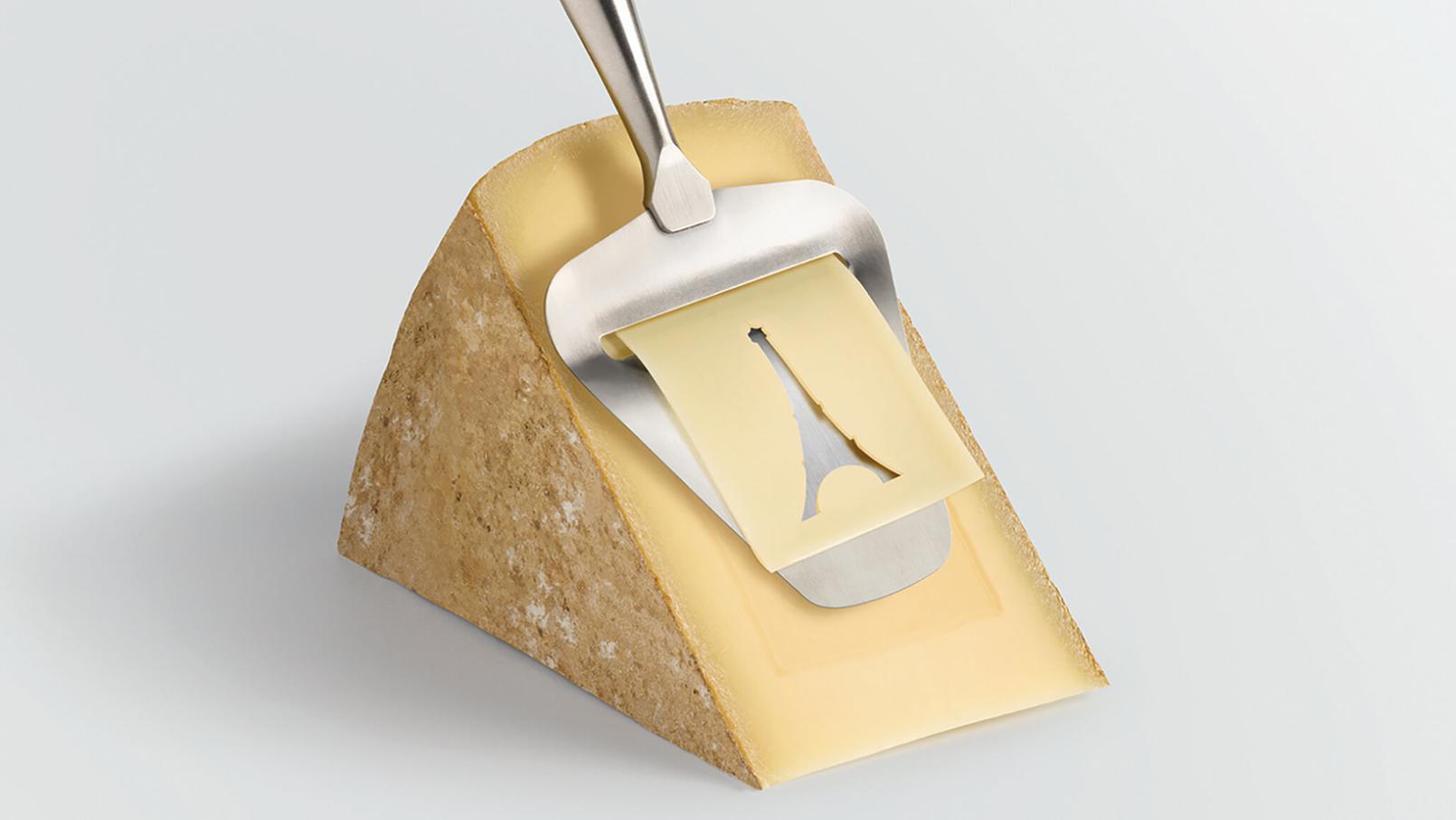 Visuel du Salon du fromage 2020 morceau de Conté avec raclette formant un pochoir de la tour Eiffel