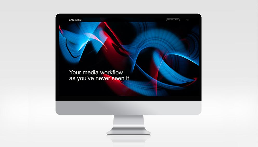 Signature de la marque Embrace sur fond workflow sur un ordinateur mac